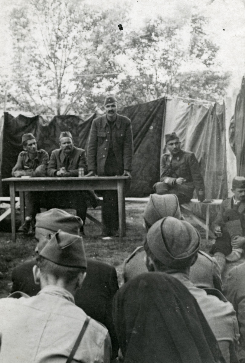 Bosnian partisans hold a meeting in the woods.