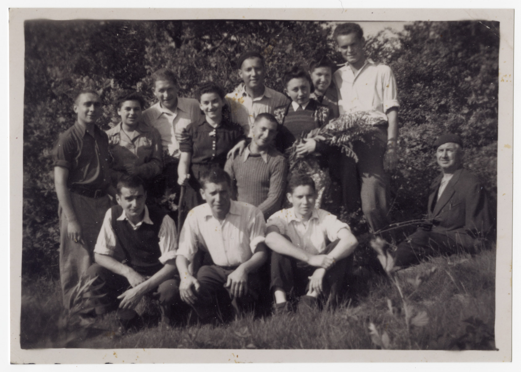 Group portrait of Jewish displaced persons in Corbion, Belgium.  Hanka Wajblum is standing in the second row, second from the left.  Alex Cige is standing, second row, on far left and Marta Bindiger-Cige is standing second row, fourth from left.