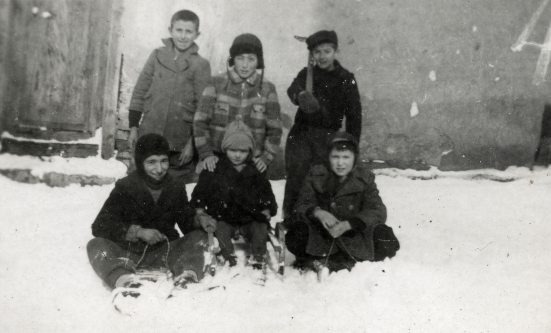 Raul Teitelbaum and his friends play in the snow.  Raul is in the second row, center.