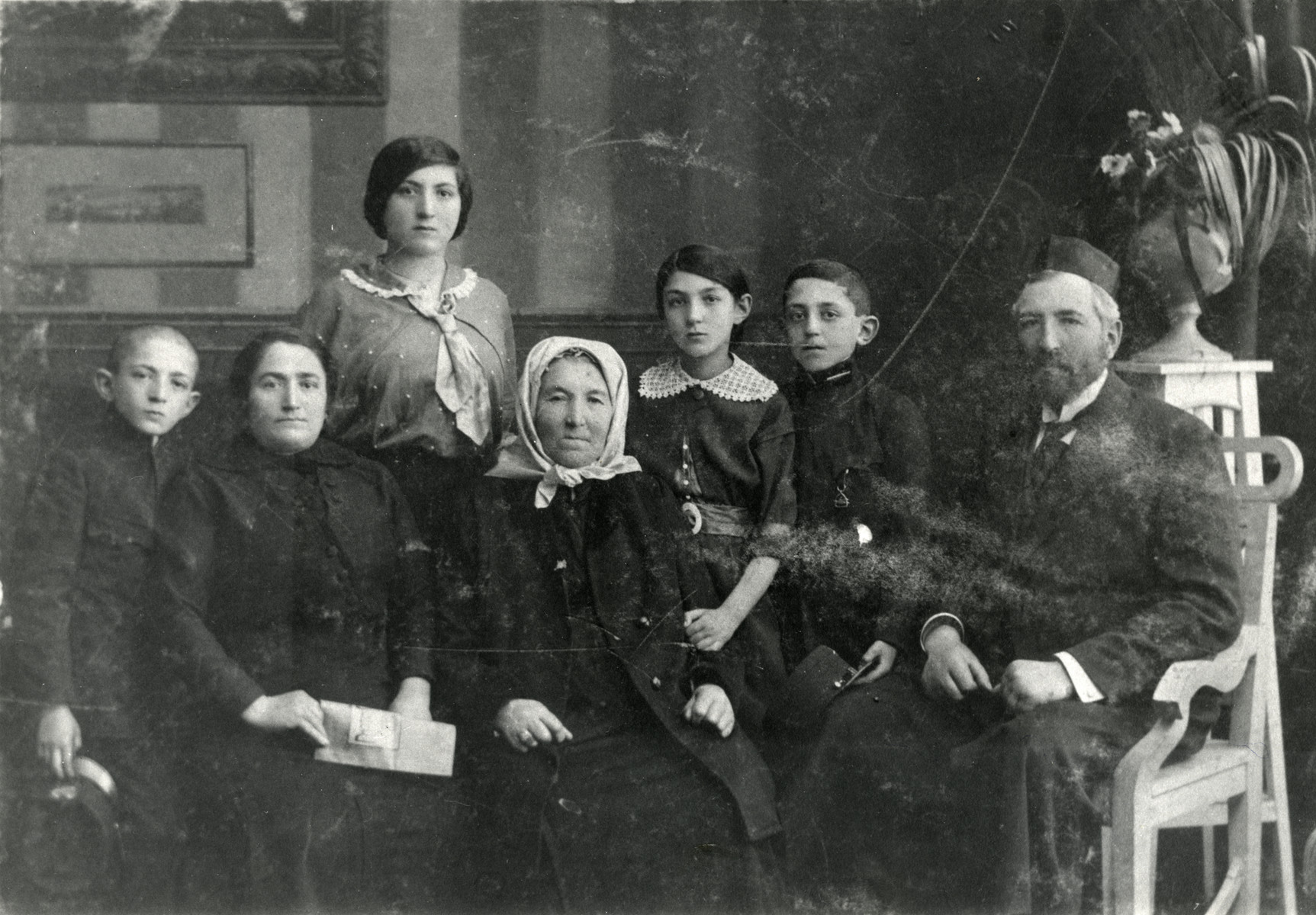Studio portrait of the Weiselberg family.  After the father Nahum Weiselberg died in a typhus epidemic, his wife Ettel moved to Vienna.  Two children, Salo and Sala immigrated to Palestine.  Another son David became a doctor and immigrated to America.  The second daughter Paula is the mother of the donor.  The grandmother Ettel was deported to Theresienstadt and perished in the Holocaust.