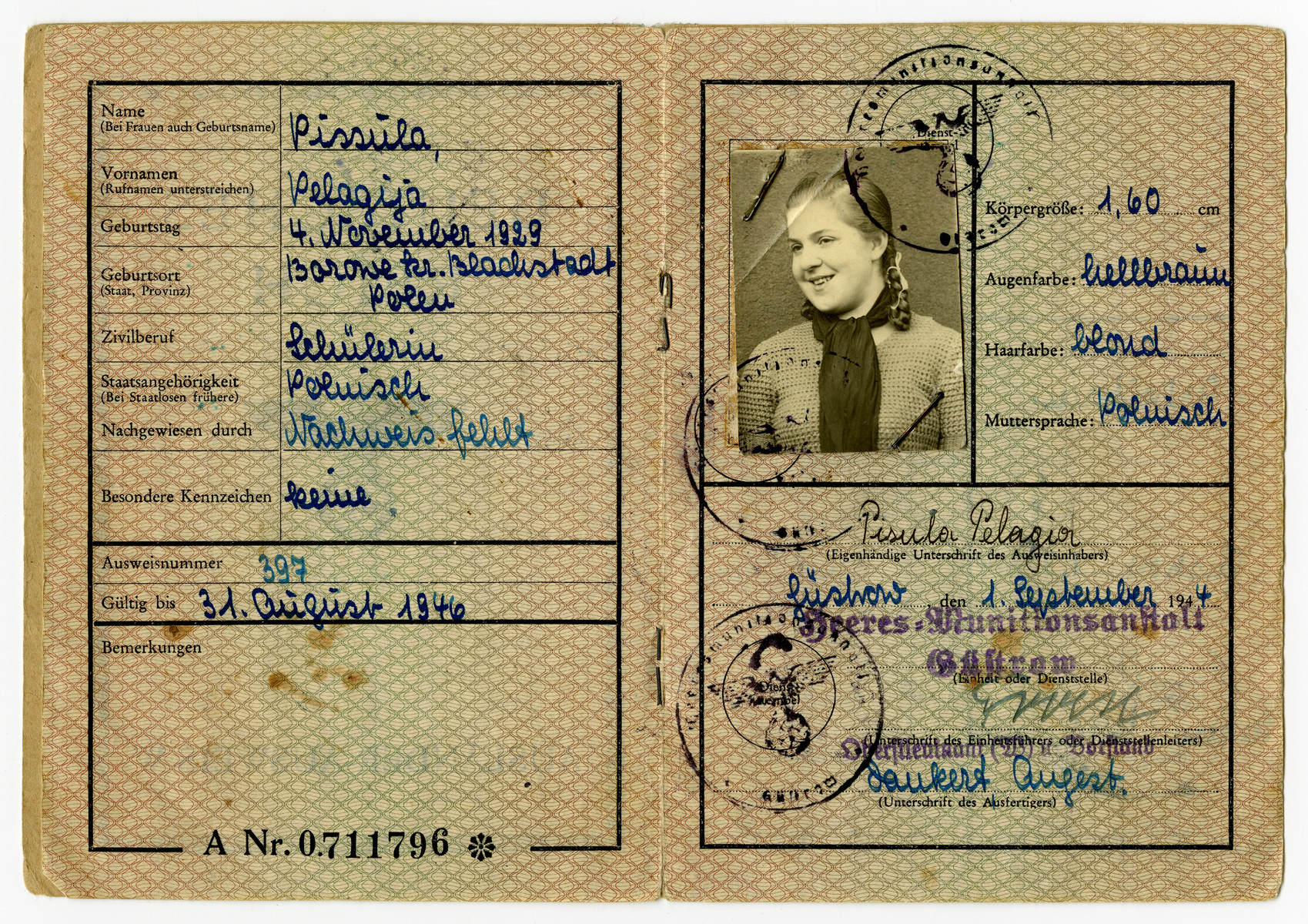 Interior page of an alien identification card for Pola Fogelman, hiding as a Polish Catholic, under a false name Pelagia Pisula..    The cover shows an eagle and is titled foreign worker.