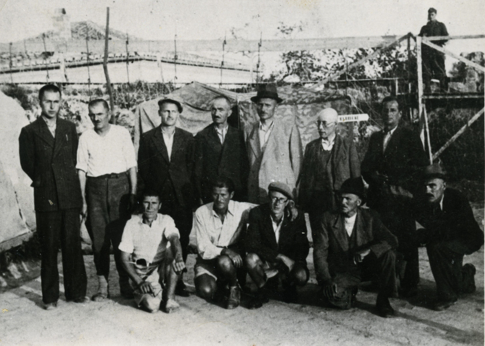 Group portrait of prisoners in the Preza concentration camp.  Dr. Joseph Teitelbaum is standing second from the right,