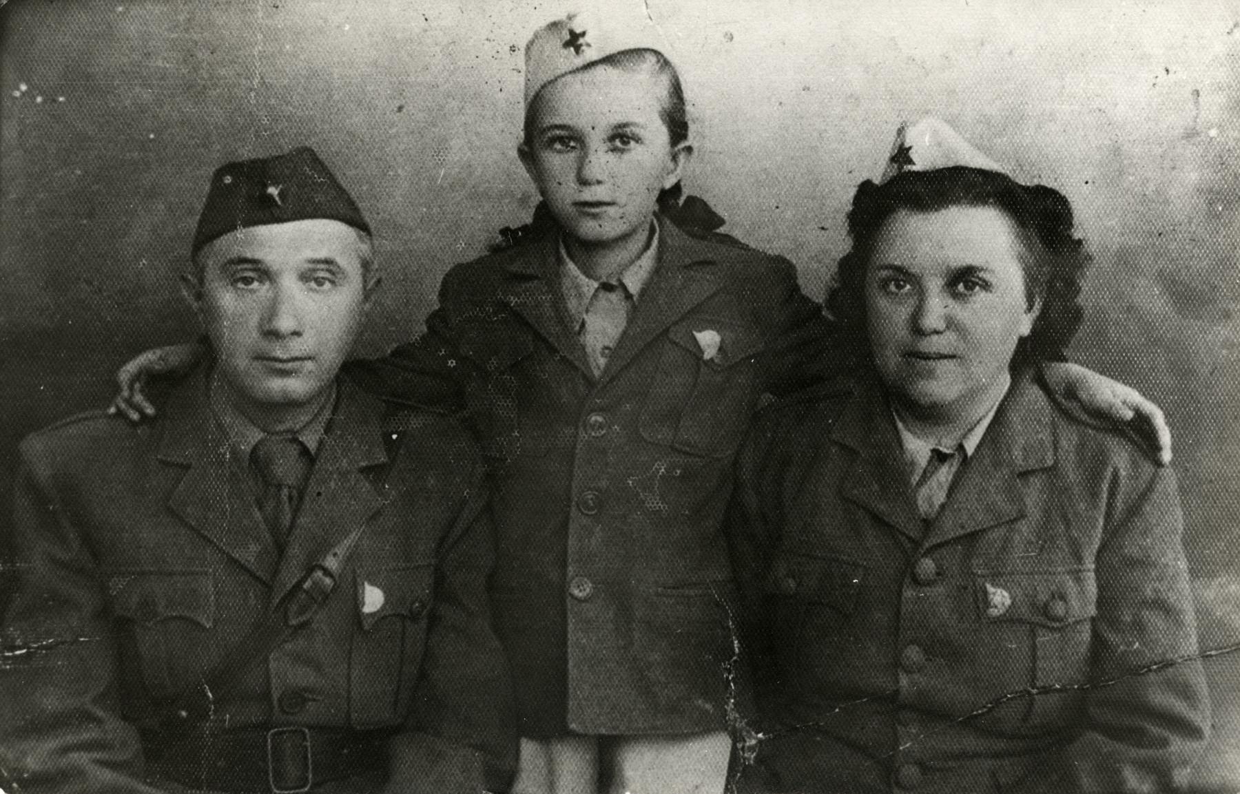 Miriam Steiner with her parents wearing Yugoslav partisan uniforms.