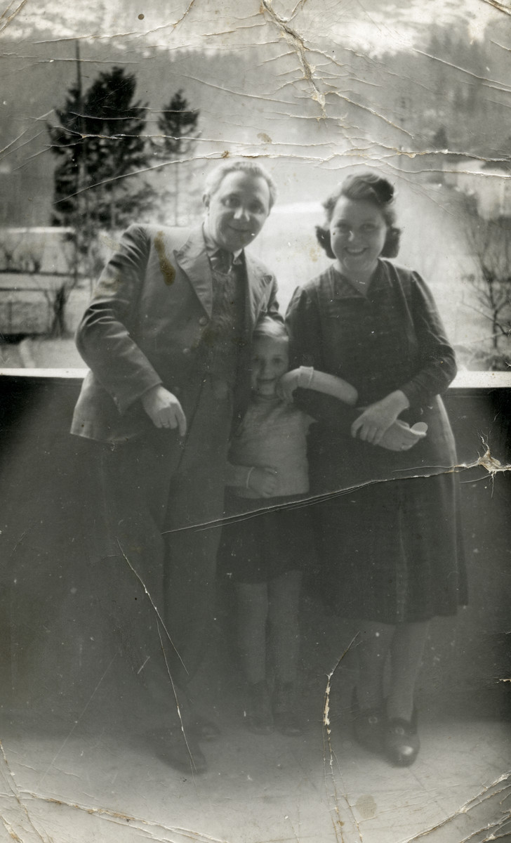 The Steiner family poses on a bridge.  From left to right are Bela, Miriam and Zora Steiner.
