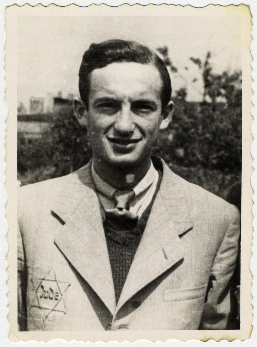 Close-up portrait of a German Jew in the Lodz ghetto wearing a Star of David.   Pictured is Maniek Kaplan.