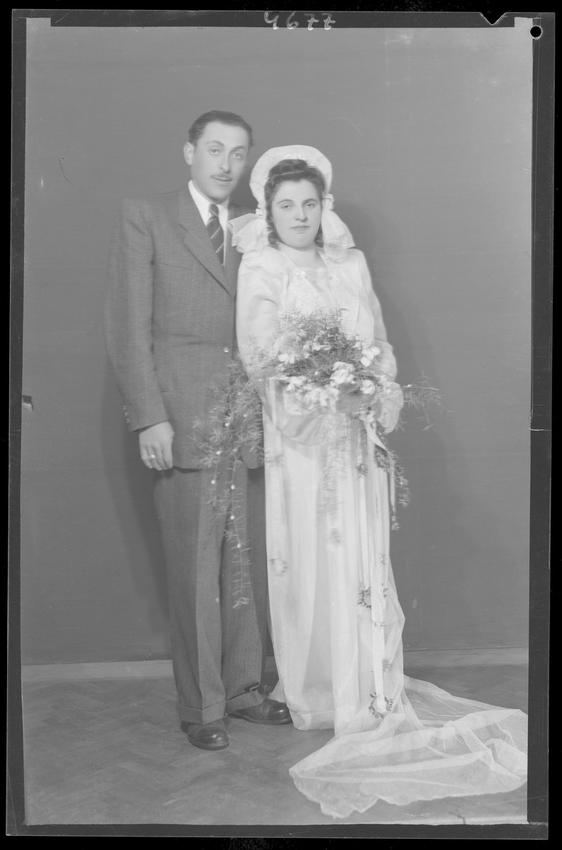 Studio portrait of the Iszak wedding.