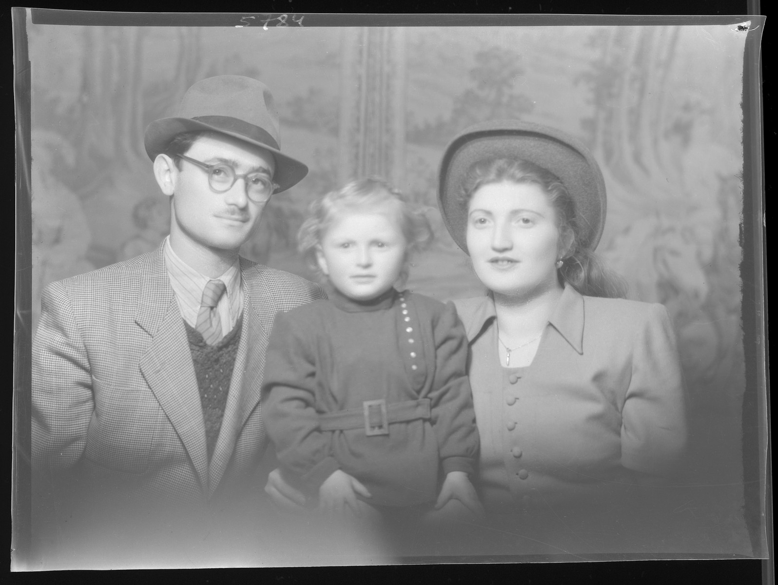 Studio portrait of Samuel Herskovits, his wife and child.