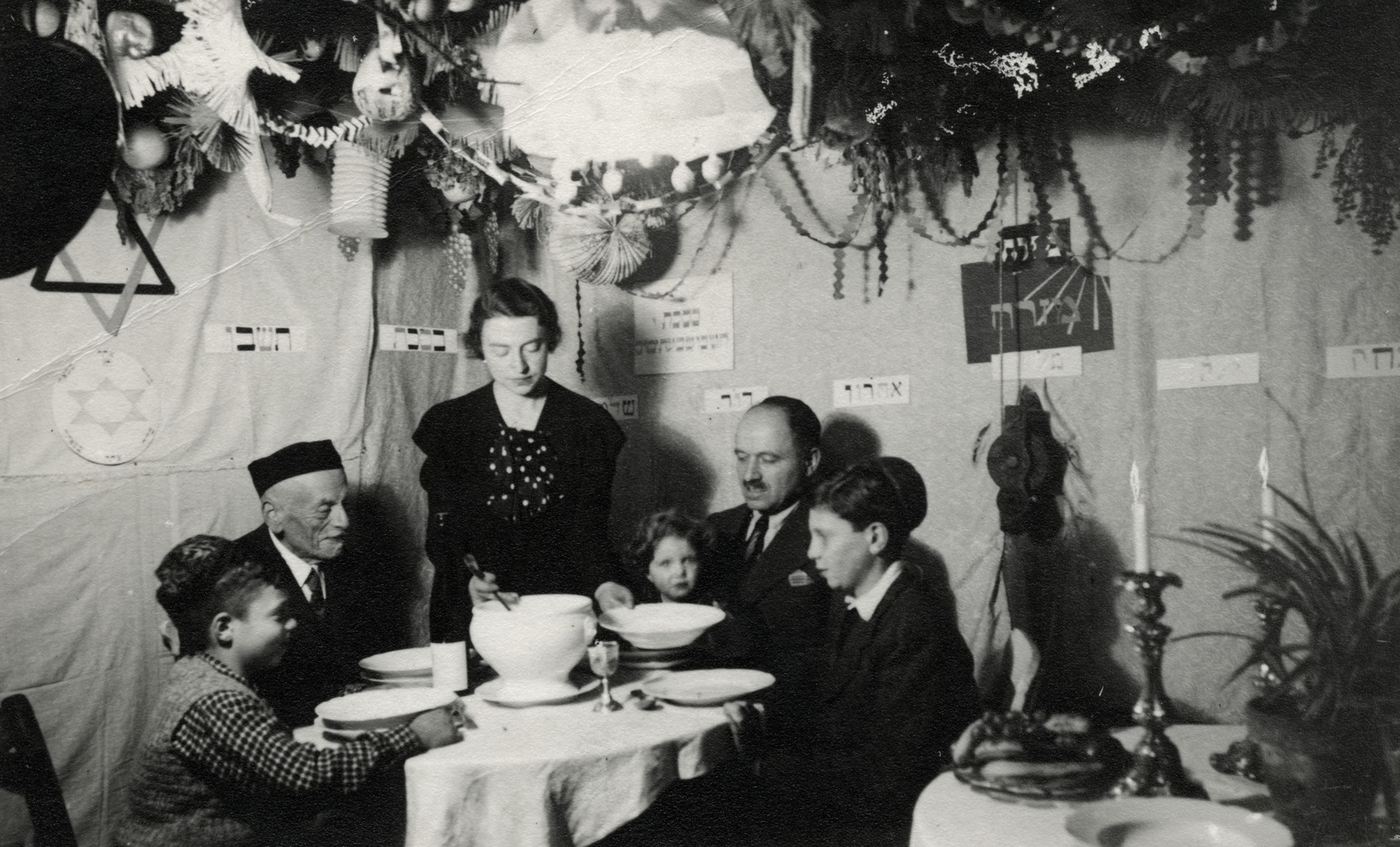 The Reutlinger family celebrates Sukkot in their home in Pforzheim.  Pictured are Erich Reutlinger, Maurits Hamburger, Elsa, Ruth, Louis and Shlomo Reutlinger.