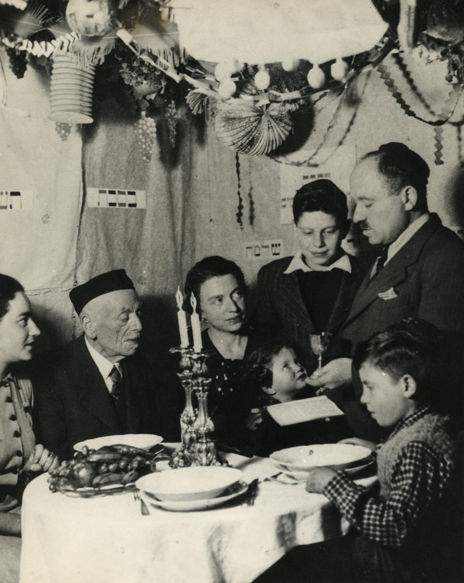 The Reutlinger family celebrates Sukkot in their home in Pforzheim.  Pictured are Maurits Hamburger, Elsa, Ruth, Shlomo, Louis and Erich Reutlinger.