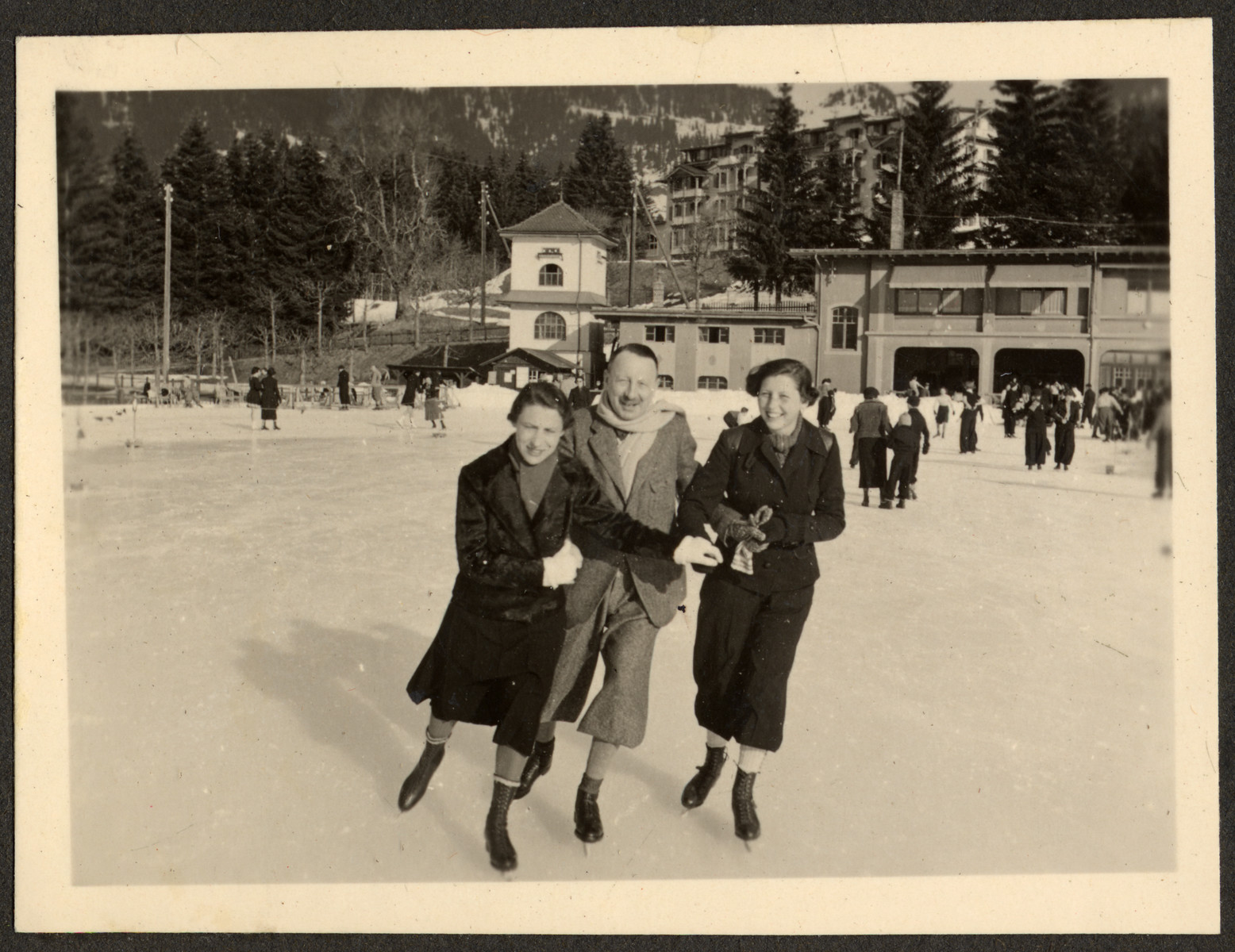 The Bing family goes skating (possibly in Switzerland).  From left to right are Erna Stern Bing, Ernst Bing, and Annelise Bing.