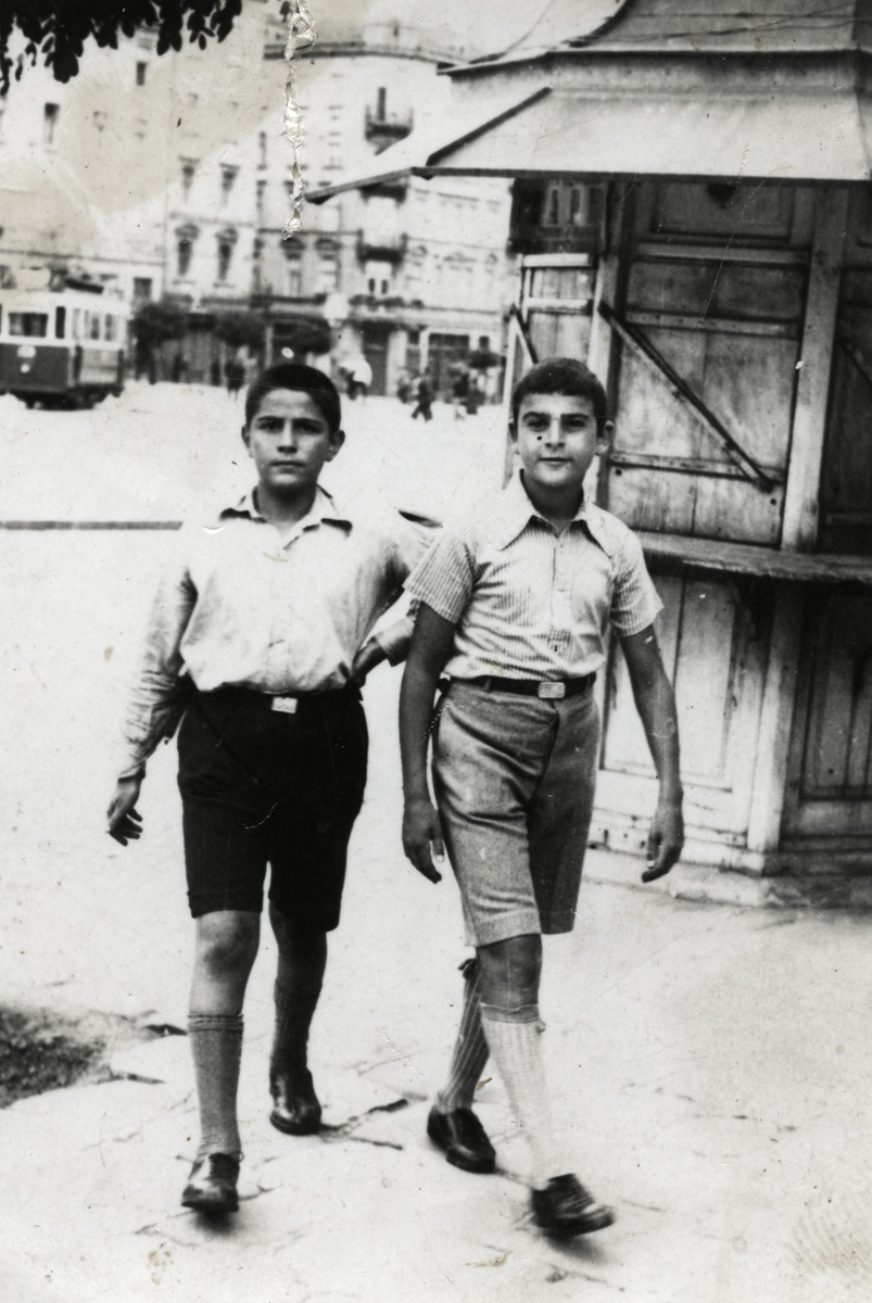Leon and Joseph Dekalo walk down a street in prewar Sofia.