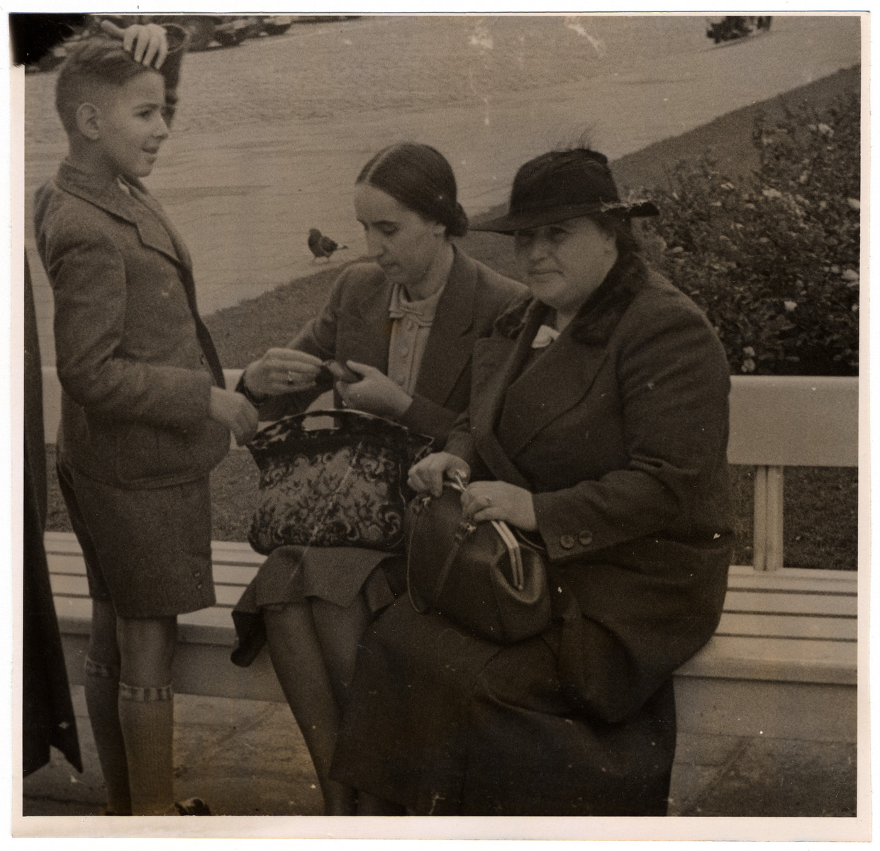 Franz Liebermann and his mother visit a park shortly before they emigrated from Nazi Germany.  Lotte Lieberman is seated on the left.  Her mother Hedwig Orgler is on the right.