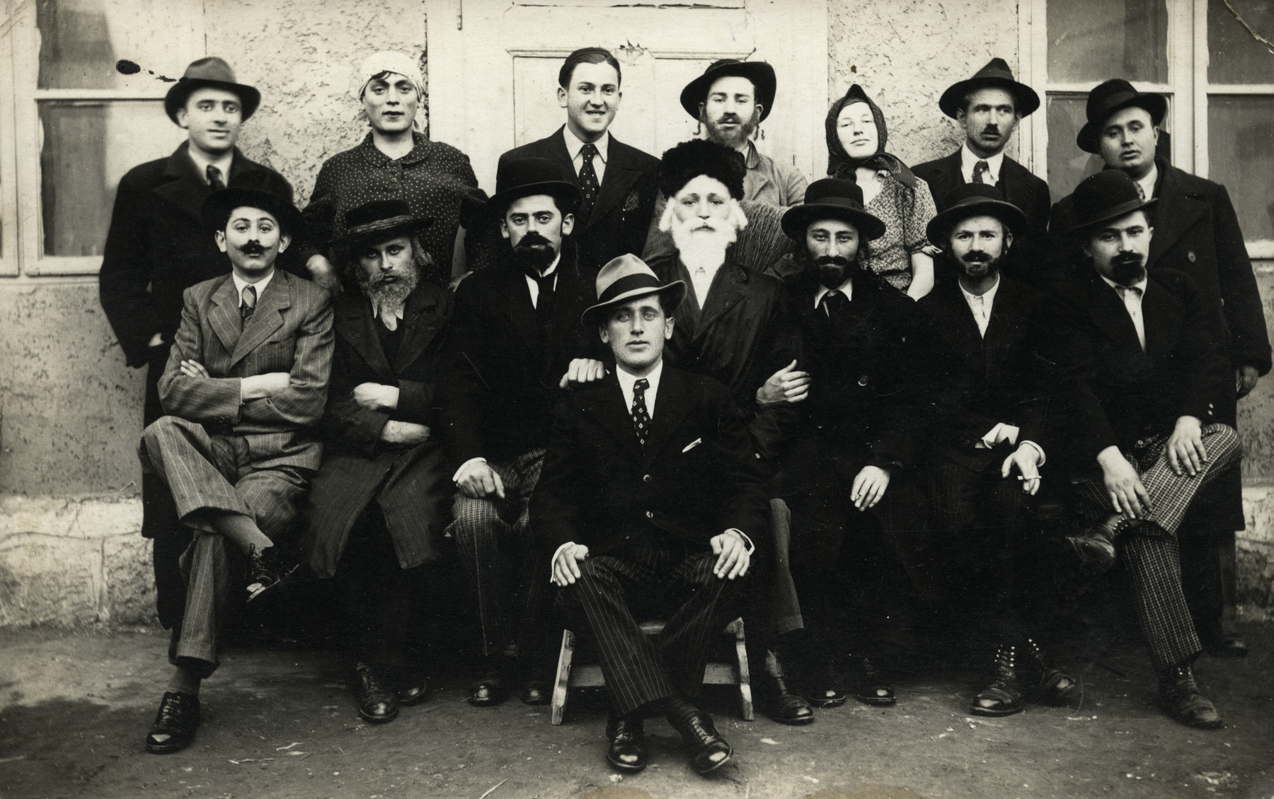 Group portrait of young people in Kisvarda dressed in their Purim costumes.  Moshe Steiger is sitting to the bottom right.