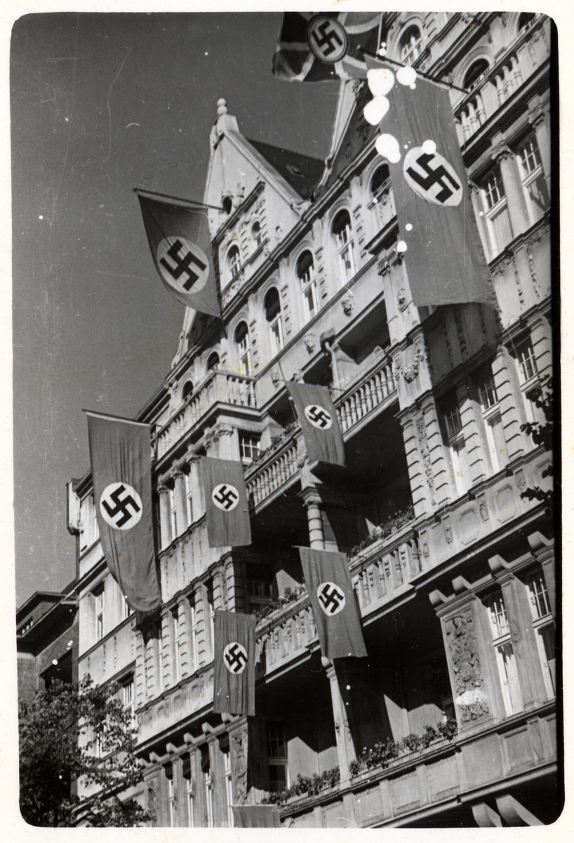 Swastikas hang from a building in Berlin.   [This image from Germany was found in the P-20-1939 contact book]