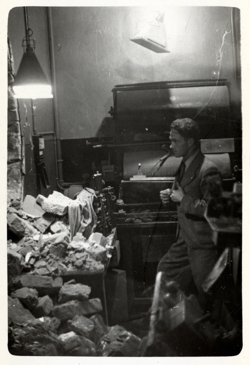 A man views the bomb damage to the Kodak film laboratory in besieged Warsaw.