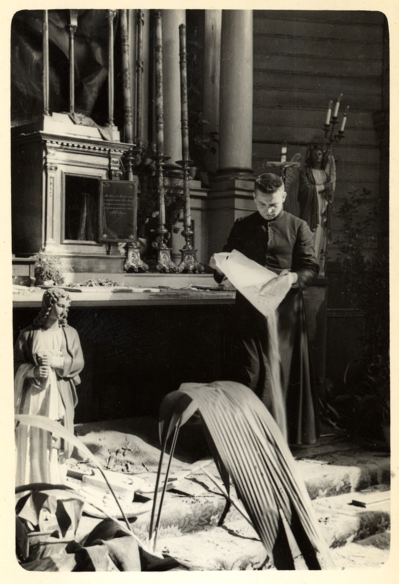 Father Wlodarczyk tries to clean and repair a bombed-out church in the besieged city of Warsaw.