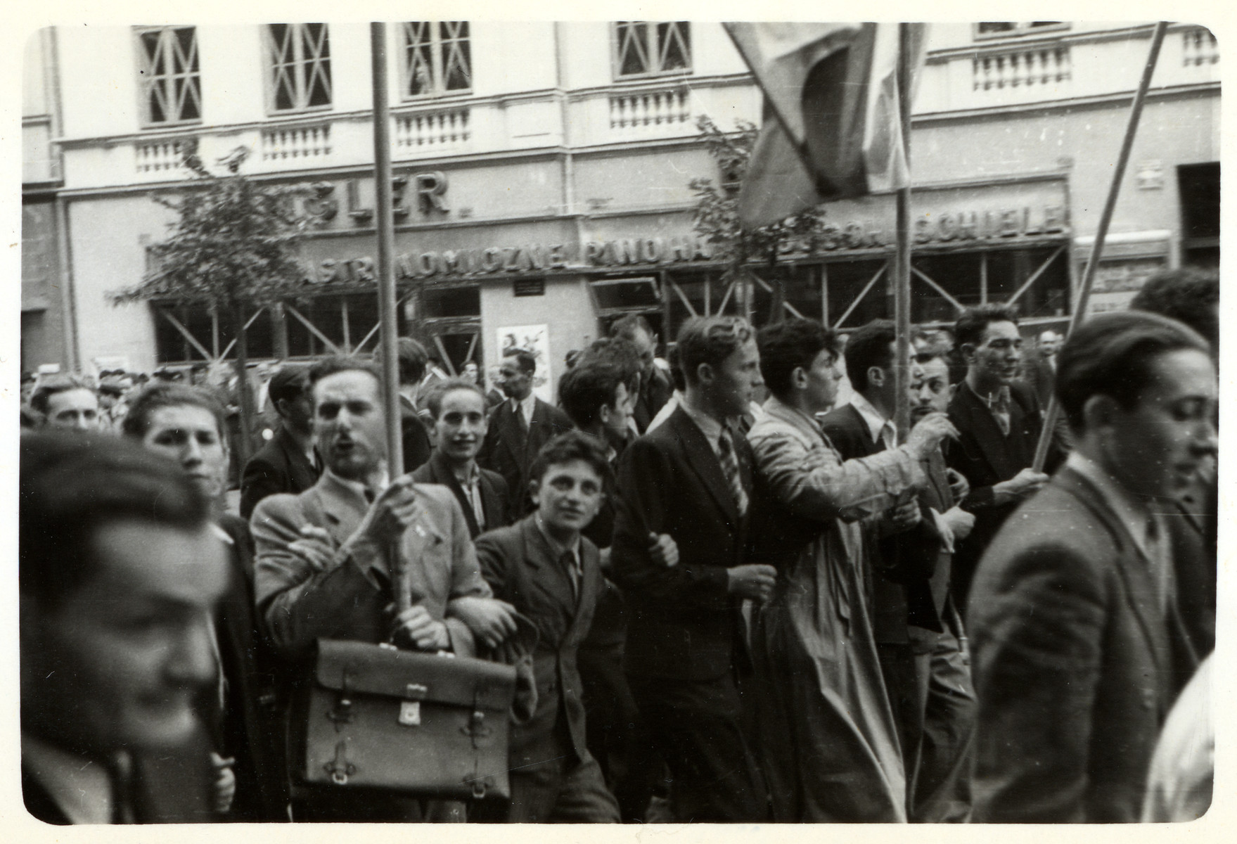 """A Moment of Confidence:"" Poles celebrate in the streets at the news that England and France declared war on Germany.   [The book ""Warsaw"" by Julien Bryan states that this photograph was taken on September 3, 1939 but Mr. Bryan himself did not arrive in Warsaw until the 7th of that month. This information does not match up, thus the tentative date.]"