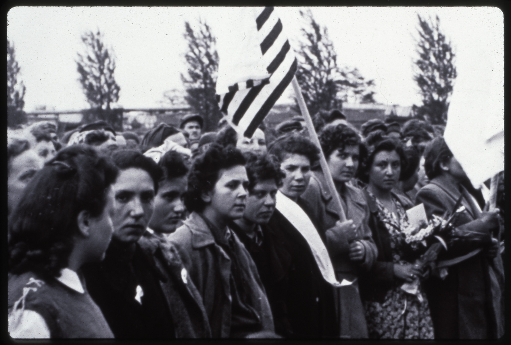 Female survivors of the Dachau concentration camp gather for a memorial service after liberation.