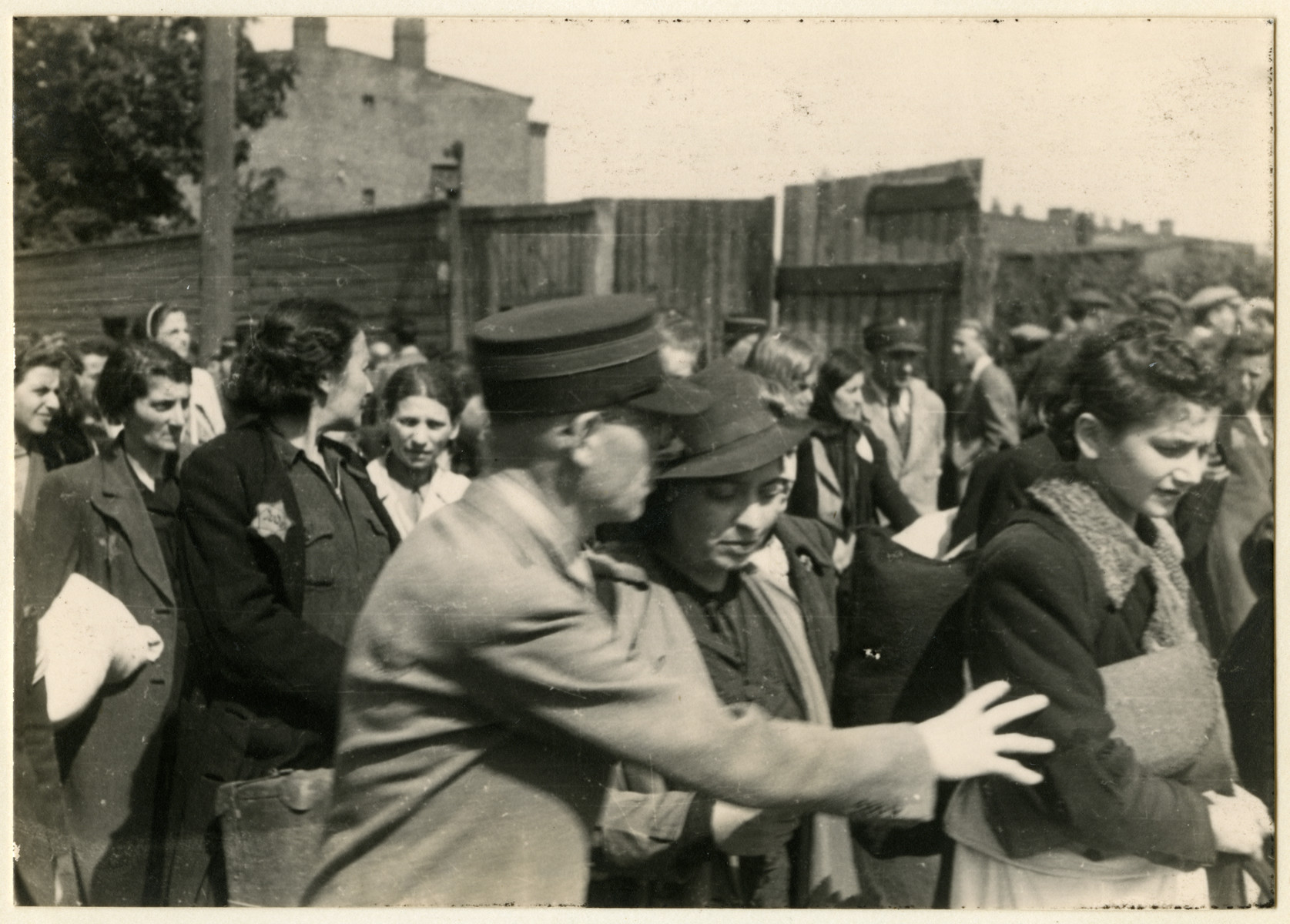 Jewish police escort a group of women who have been rounded up for deportation in the Lodz ghetto.