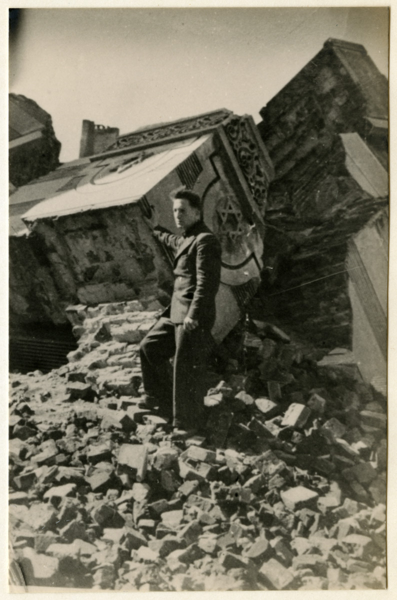 A man poses in front of the ruins of the synagogue in Wolborska Street, which was blown up by the German authorities.