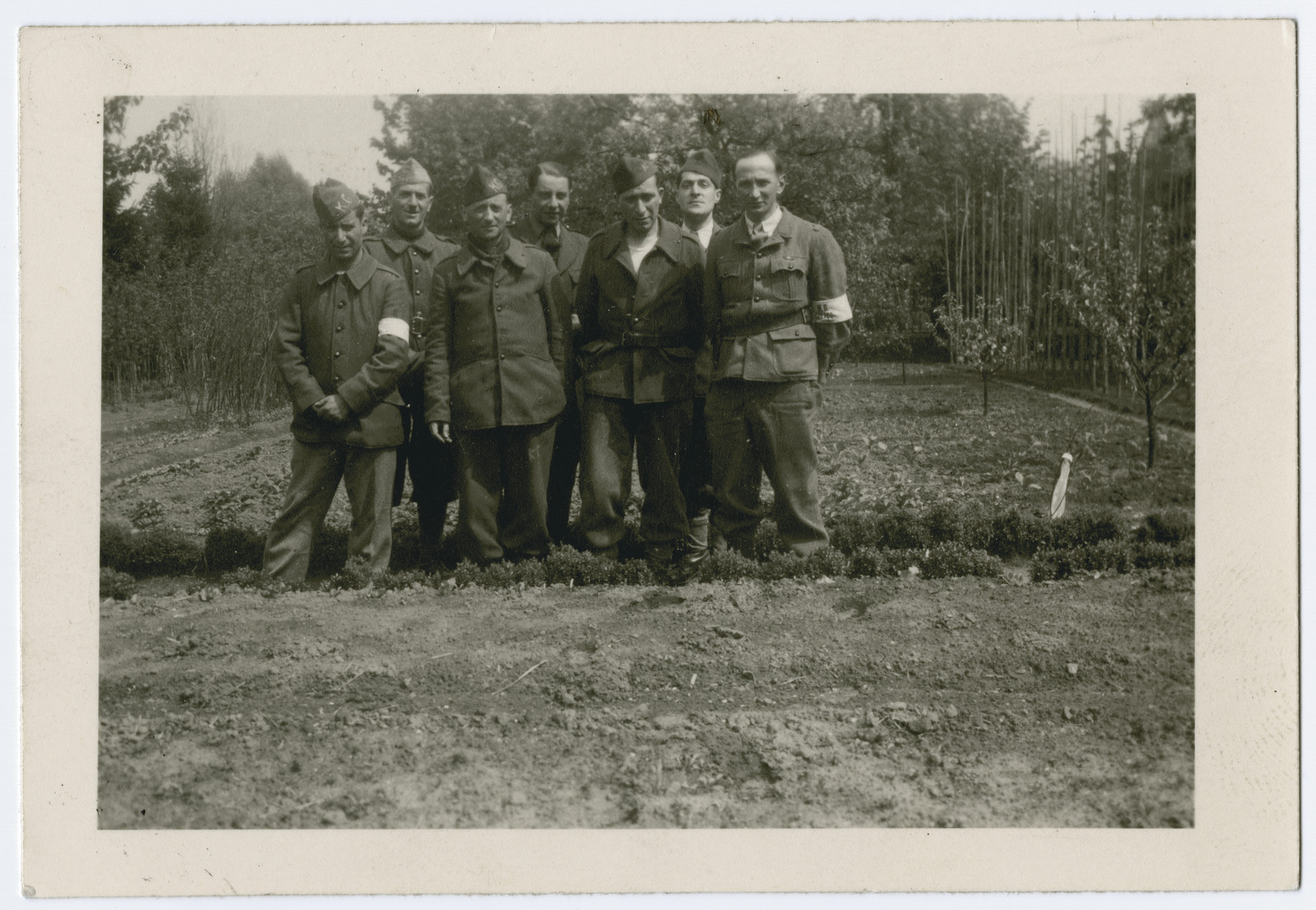 Group portrait of Belgian POWS in Stalag 10 C.  Henry Kahn is pictured on the right.