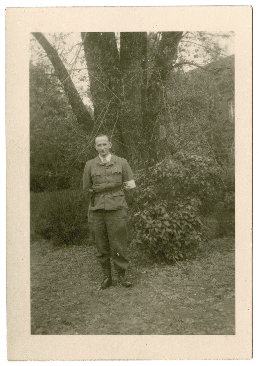 Henry Kahn poses underneath a tree in Stalag 10 C.