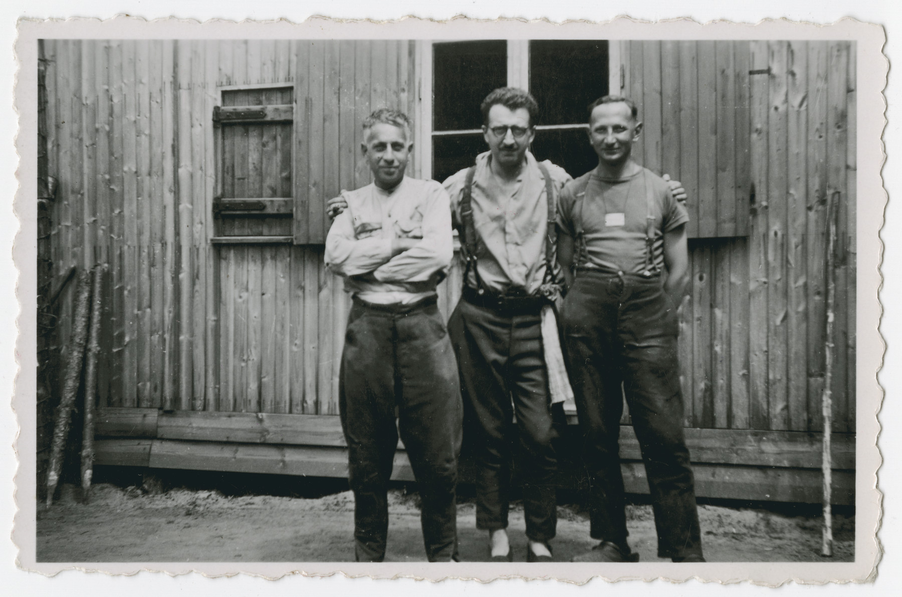 Three POWs stand outside a barrack in Stalag 10 C.  Pictured left to right .are Arnold Silberfeld, Leopold Guttman and Henry Kahn.
