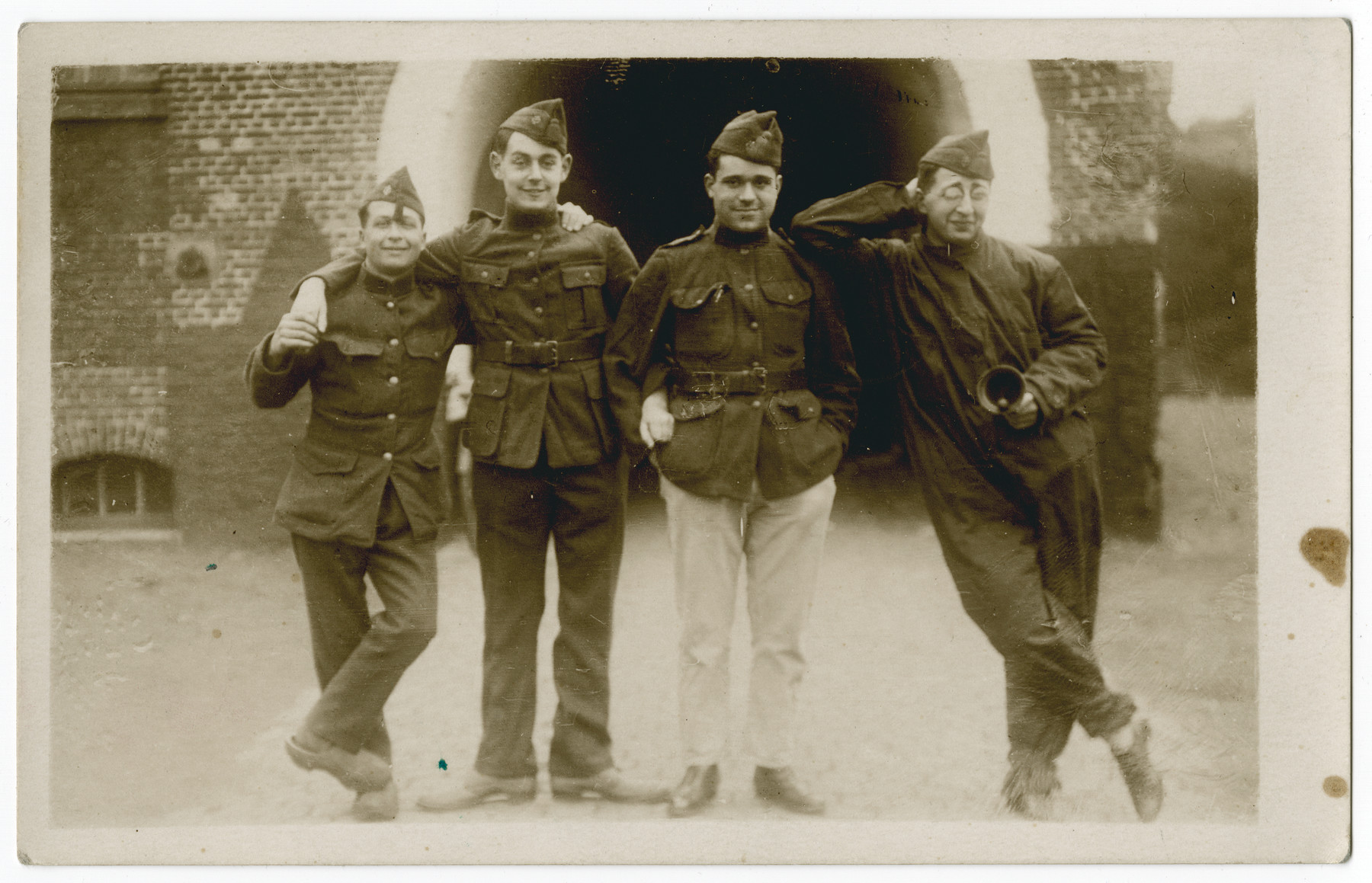 Group portrait of four POWs.  Leopold Guttman is pictured on the right.