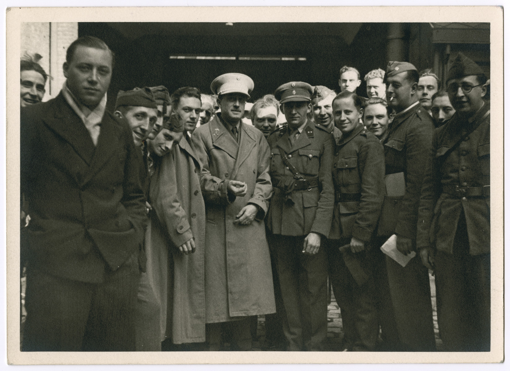 Prewar group portrait of Belgian soldiers and civilians.  Leopold Guttman is pictured standing,far right.