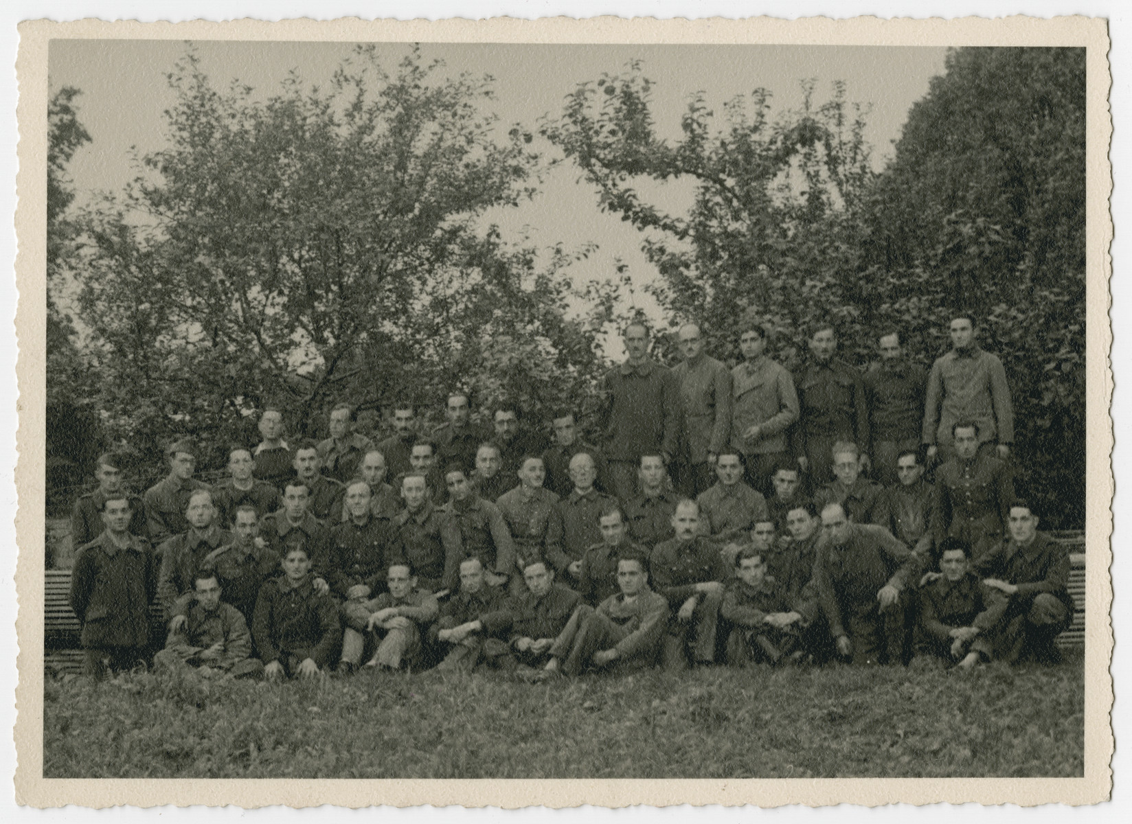 Group portrait of prisoners in Stalag 10 C.  Leopold Guttman is pictured in the top row, center.