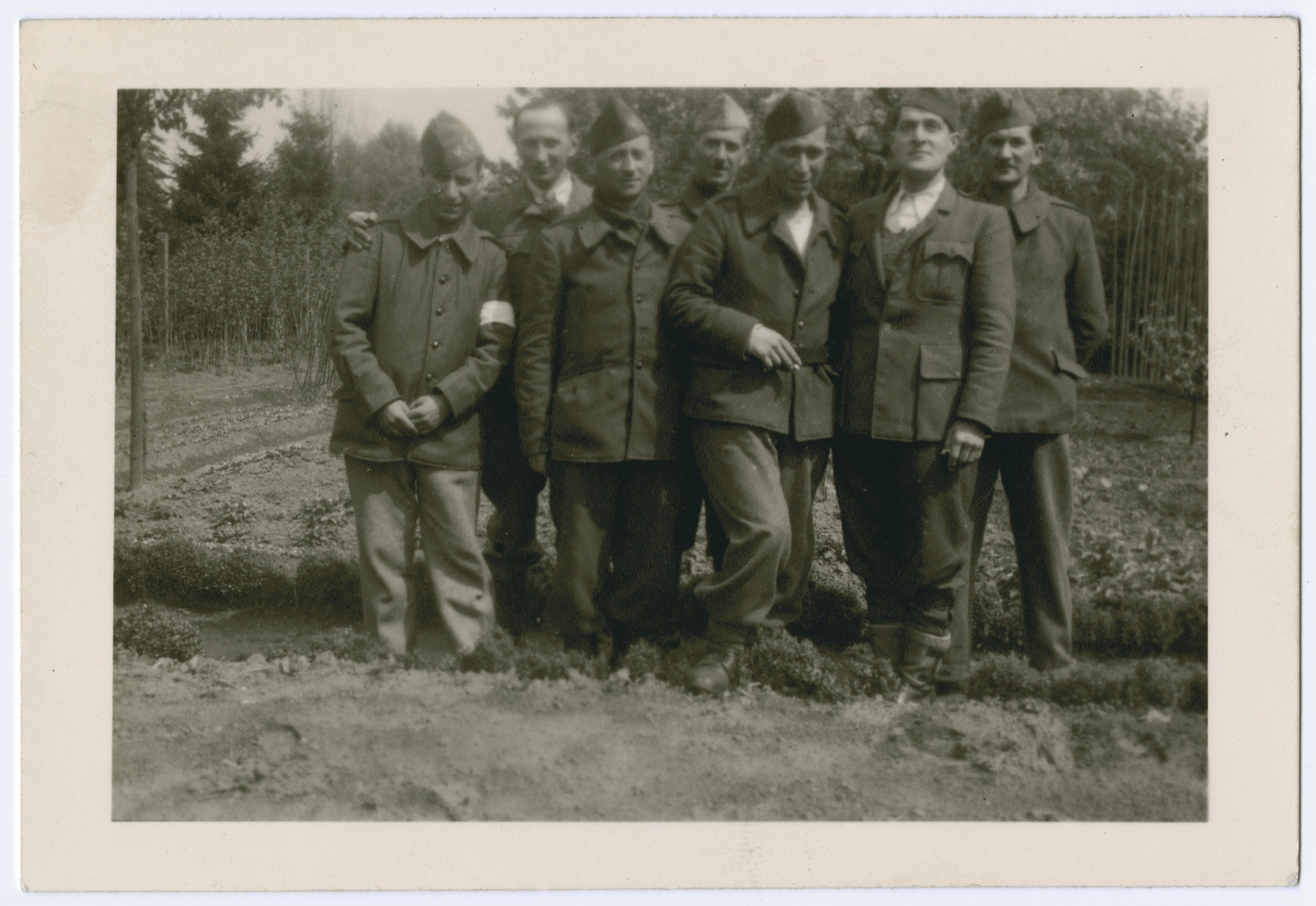 Group portrait of Belgian POWS in Stalag 10 C.  Henry Kahn is pictured second from the left.