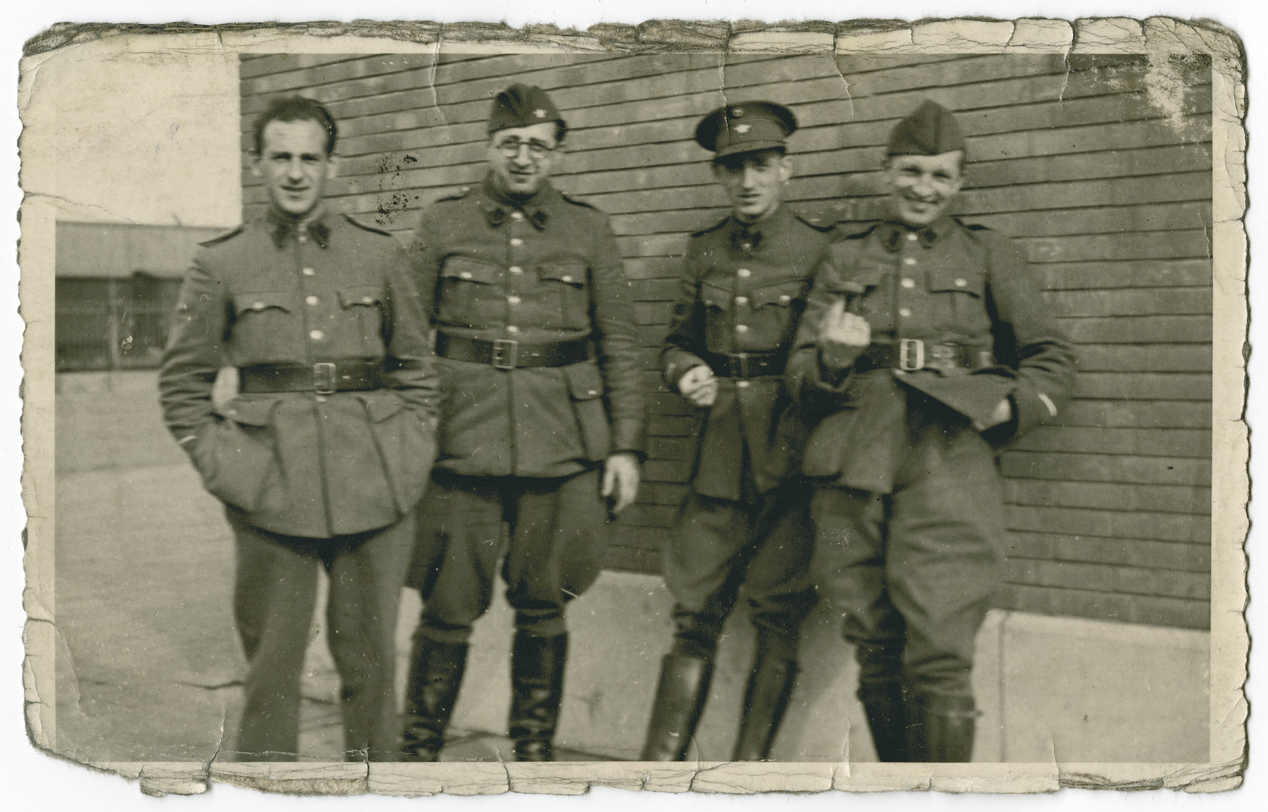 Group portrait of four POWs in Stalag 10 C.  Leopold Guttman is pictured second from the left.