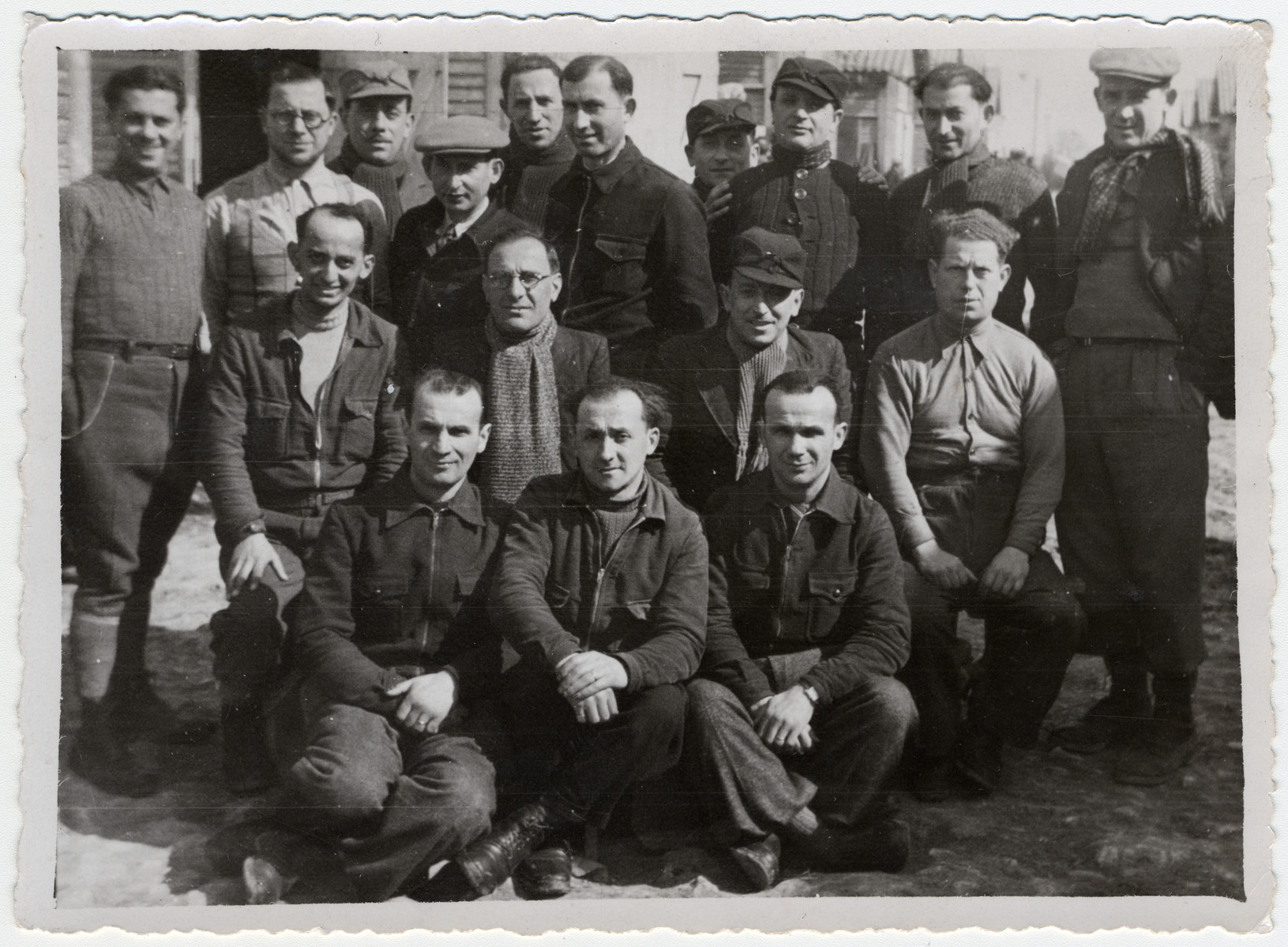 Group portrait of prisoners in the Beaune-la-Rolande internment camp.  Jankiel Sztal is pictured sitting (middle row, far left).  His brother Moishe is standing second from the right.