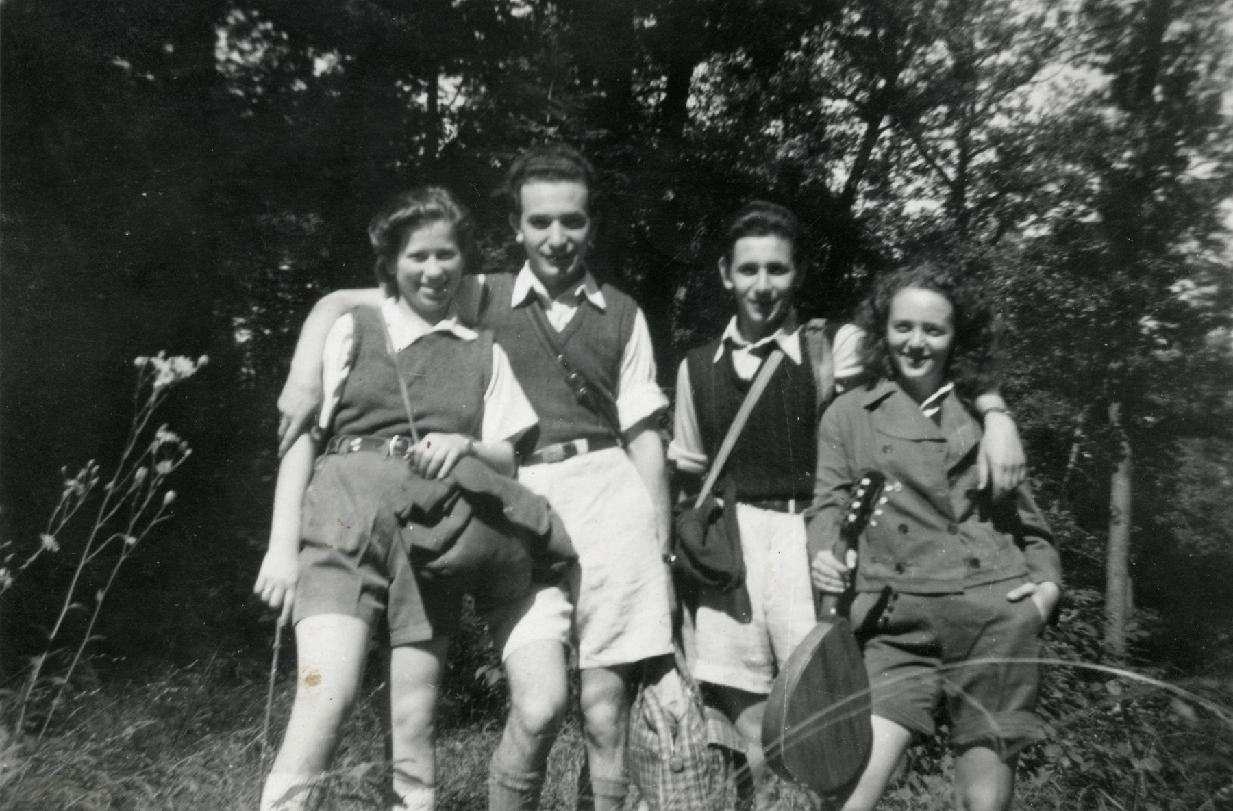 Group portrait of four members of the Hungarian Zionist resistance group.  From left to right are Tzippy and Ephraim Teichman, David Gur and an unidentified friend.