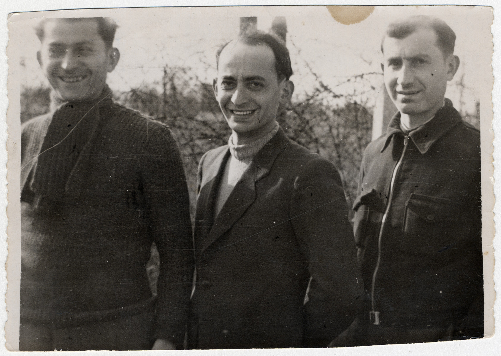 Close-up portrait of three Jewish men in the Beuane-La-Rolande internment camp.  Pictured are Chil Sztal, Jankiel Michalowiciz and Moishe Sztal.  The original caption reads: To my dear brother in law and sister in law and our dear cousins.  We are sending you this photograph as a remembrance of our time in the Camp Beaune-la-Roland.  Passover 1942.