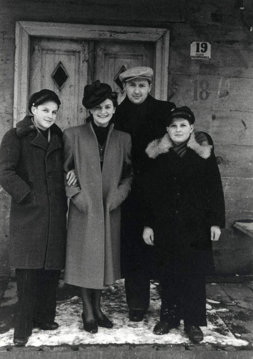Members of the Volovelski pose outside a home [in either Pruzhany or Drohichin]  From left to right are Jacob Volovelski, Feigele (a cousin from Drohichin), Moshe Volovelski, and Eliyahu Volovelski.