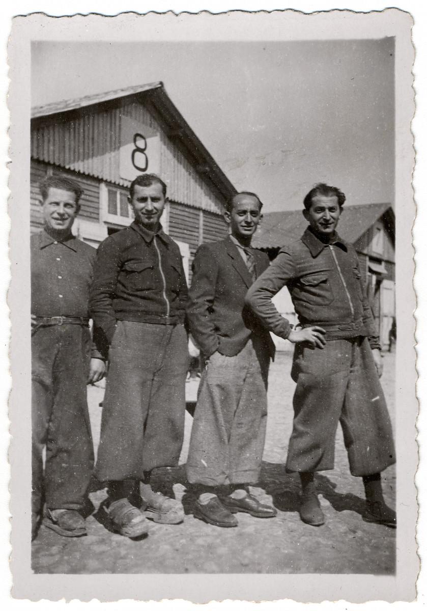 Group portrait of Jewish prisoners outside barrack 8 in the Beaune-la-Rolande internment camp.  Pictured left to right are Yitzrik Sztal, Moishe Sztal, Jankiel Michalowicz, and Chil Jankiel Sztal.