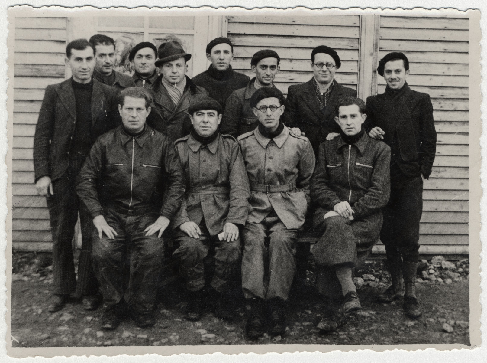 Group portrait of Jewish prisoners in the Beaune-la-Rolande internment camp.  Pictured seated is Itzrik Sztal (far left).  Standing are Moishe Sztal (far left), Chil Jankiel Sztal (second from left) and Jankiel Michalowicz (sixth from the left).