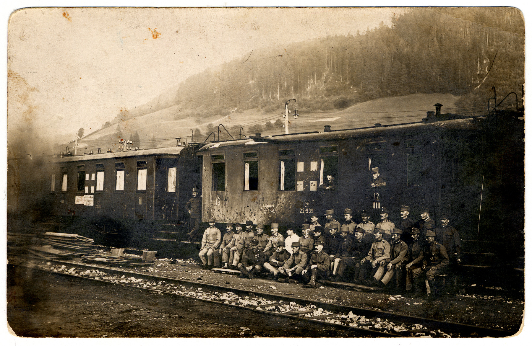 Hungarian soldiers pose in front of a train during World War I.  Among those pictured is Sandor Herland, the donor's grandfather.