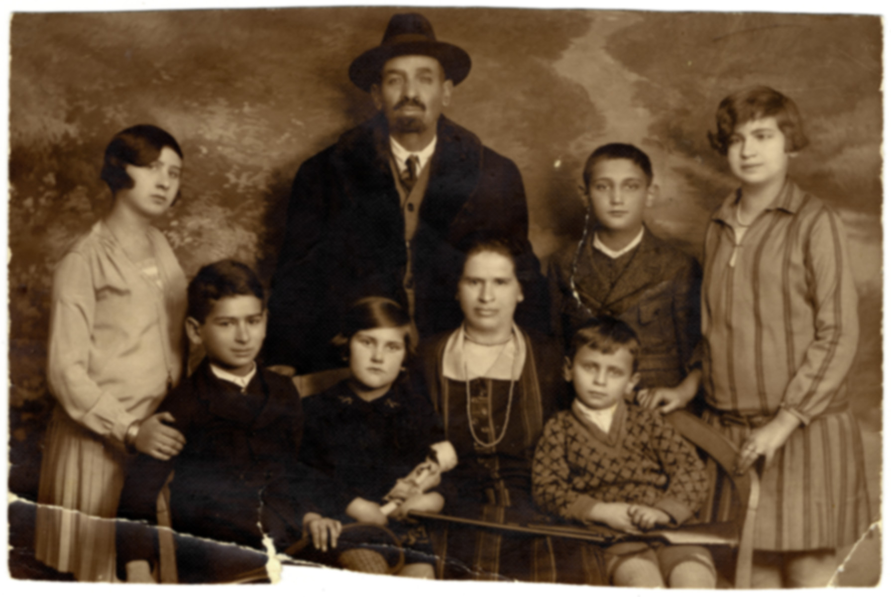 Prewar portrait of the Kleinberger family in Budapest.  Pictured in the center is Maria Kleinberger (the donor's great aunt).  Also seated are Tibor (who became a chess master and perished in the Holocaust), Edit (who emigrated) and Kishegyi Arpad (who survived and became an opera singer).  Standing are Kato (who survivied concentration camp), the father (name unknown), Laszlo (who perished in the Holocaust) and Zseni (who survived).