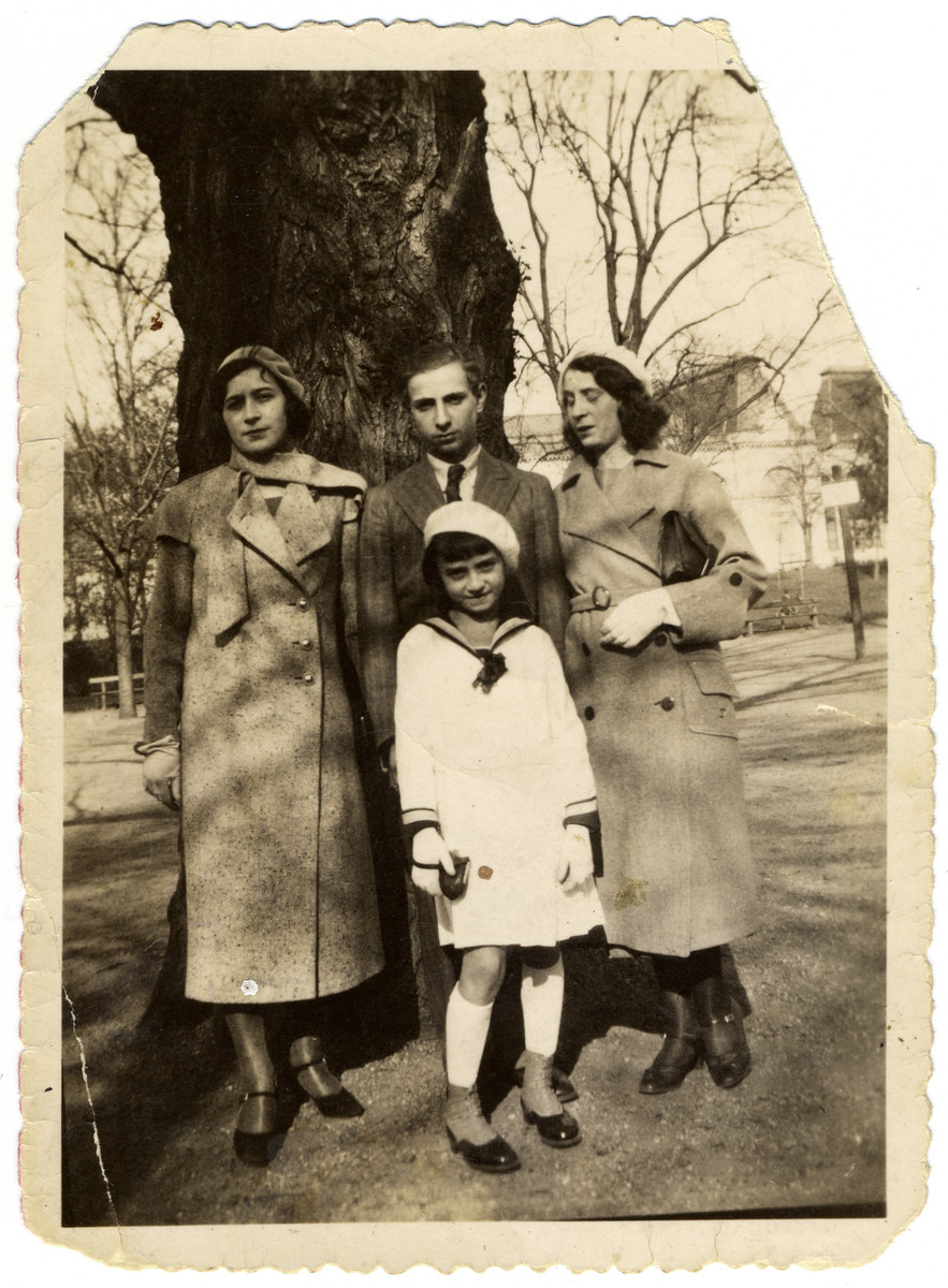 Four Hungarian siblings pose beneath a tree.  Pictured are the siblings of Katalin Biel -- Gizella, Jeno, Ibolya and Teri Herland.  All four were deported to Kamenets Podolsk where they perished.