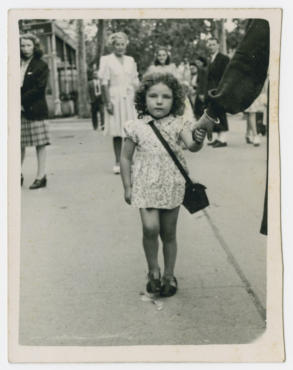 Monique Epstein walks down the street shortly after her liberation.