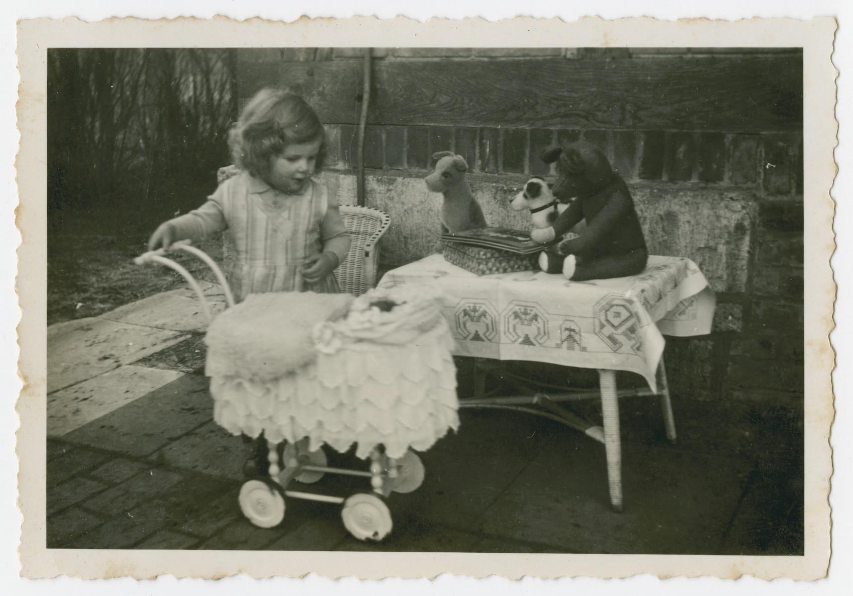Gretel David plays with her stuffed animals.