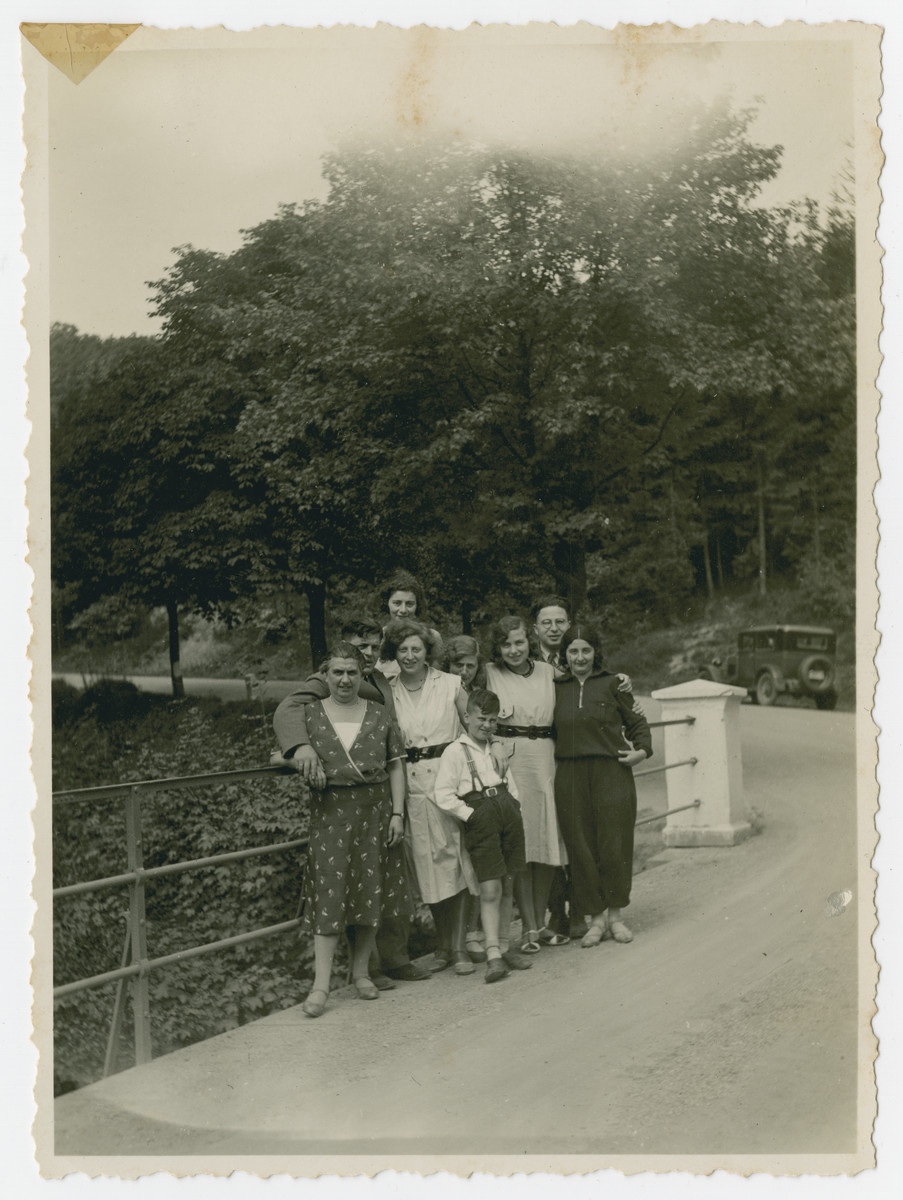 Friends and family pose by a fence while on an excursion in the German countryside.  Among those pictured are Julius and Else Gutheim, Edith Kleeblatt, Walter Kleeblatt and Gretel David.