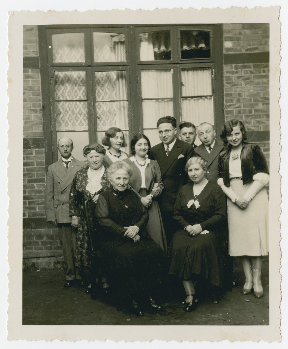 Group portrait of the extended Kleeblatt family, taken to celebrate the engagement of Walter Kleeblatt and Gretel David.  Pictured are Seated, left to right are Helene Kleeblatt; and Paula David. Standing are perhaps Walter Hirsch's brother, Ida Hirsch (Helene's sister and Walter Hirsch's step- mother), Else Gutheim, Gretel David, Walter Kleeblatt, Julius Gutheim, Arthur Kleeblatt and Edith Kleeblatt.