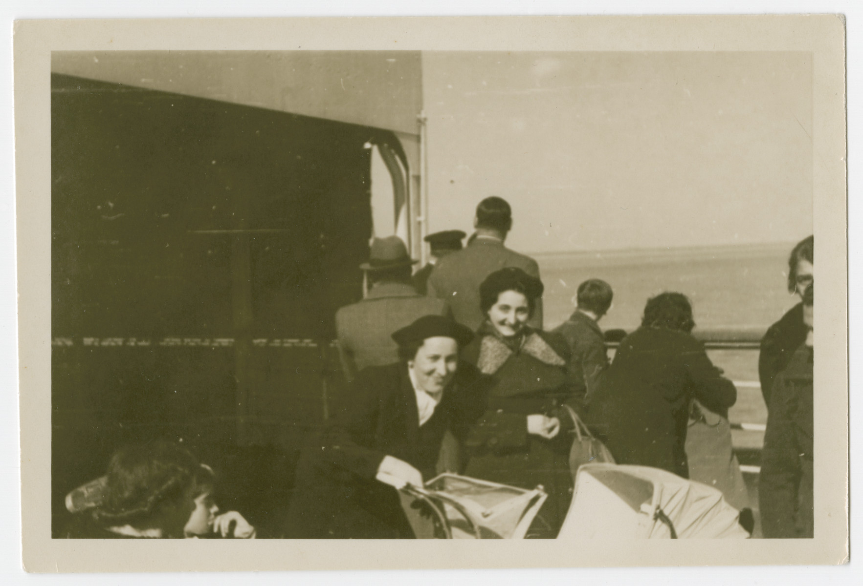 Gretel Kleeblatt (right) and another female passenger pose on the deck of the SS Manhattan while fleeing Germany for the United States.