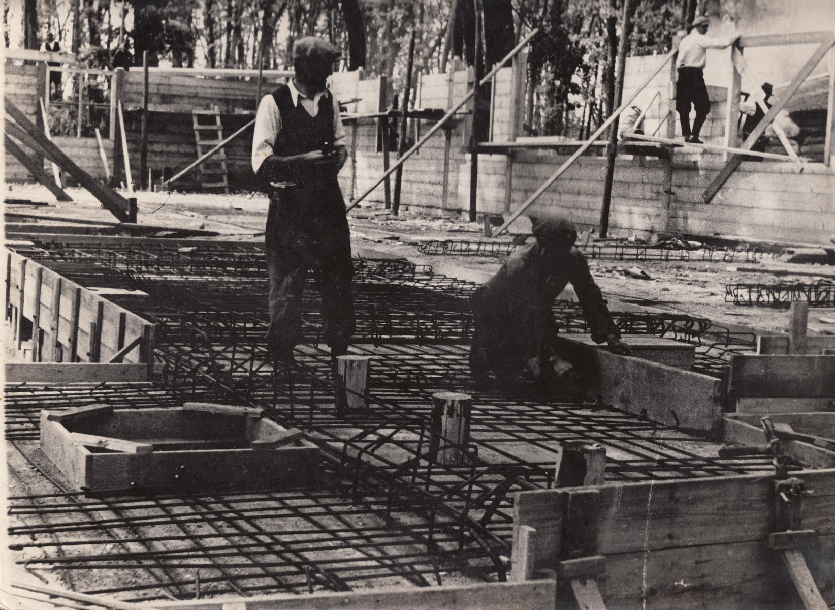 Members of a Jewish labor battalion work at a construction site in Hajduhadhaz.