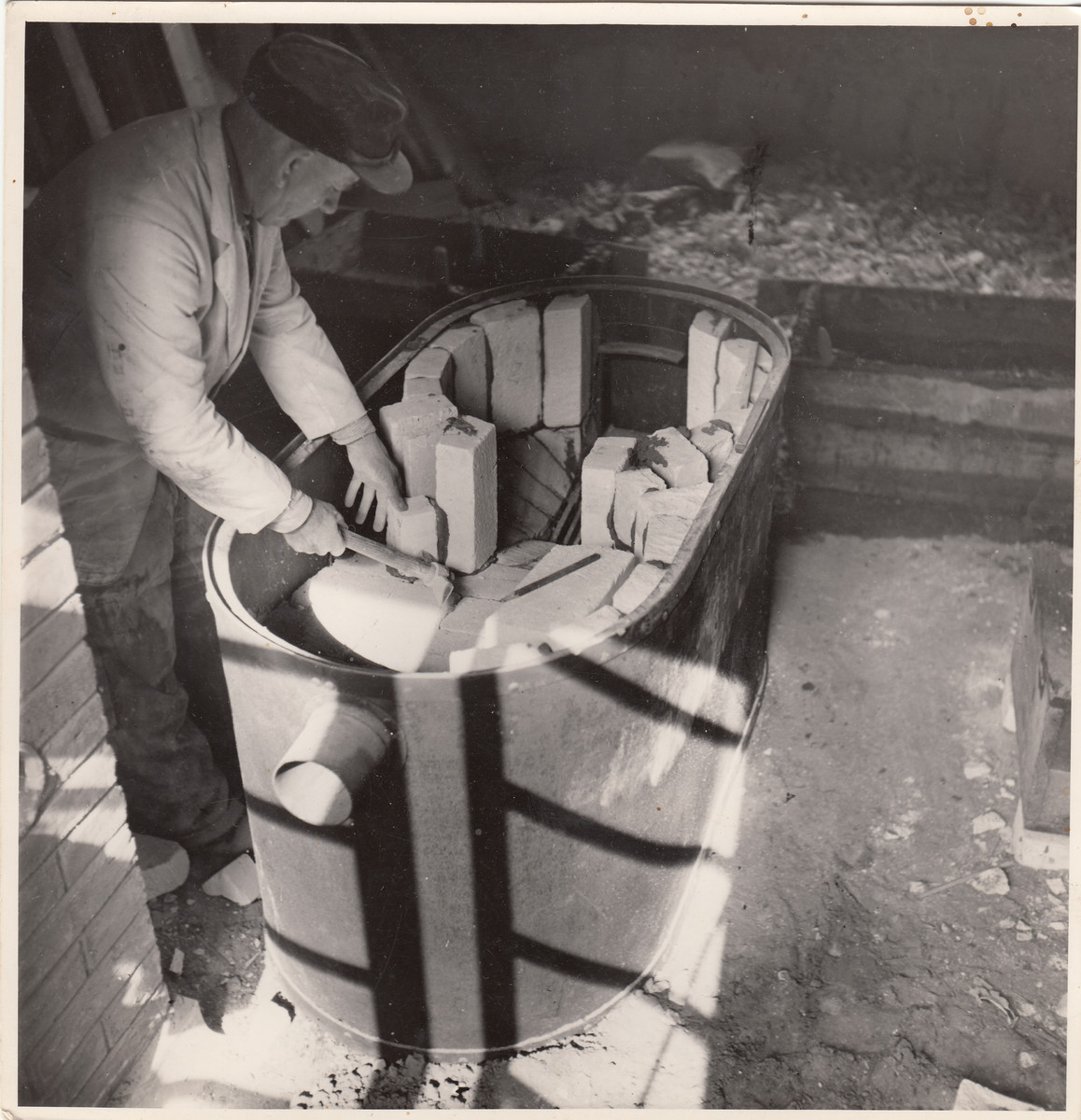 A Jewish forced laborer works at a construction site in Hajduhadhaz.