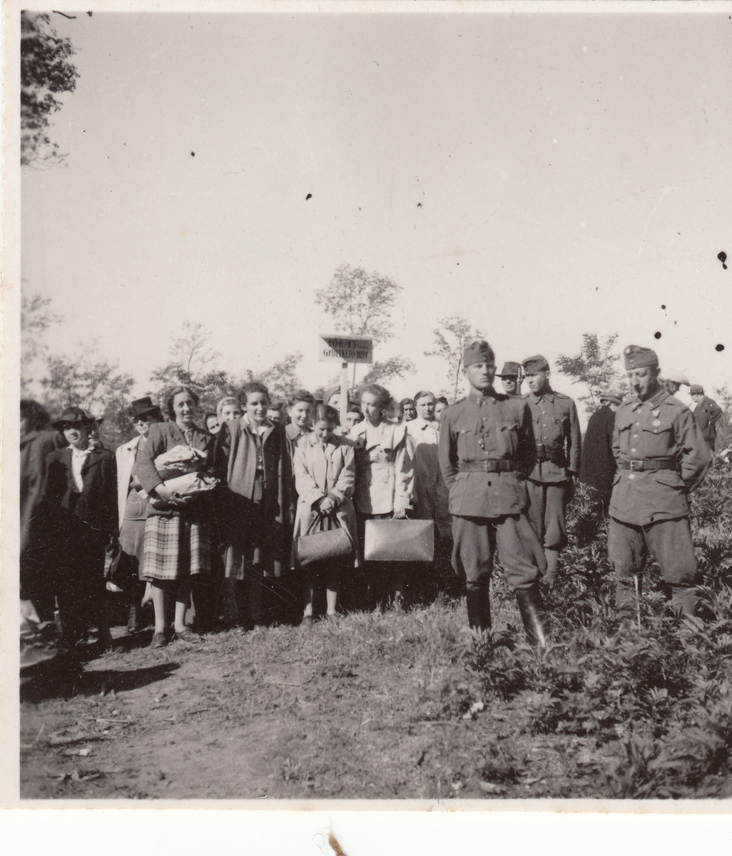A group of women, some carrying packages, visits a Hungarian labor battalion in Hajduhadhaz.