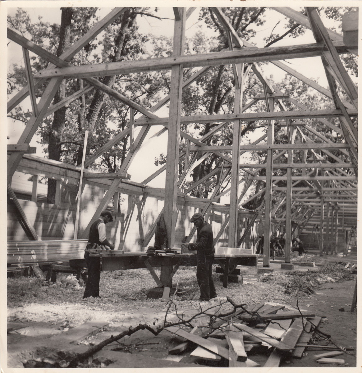 Members of a Jewish labor battalion work in a partially completed structure in Hajduhadhaz.